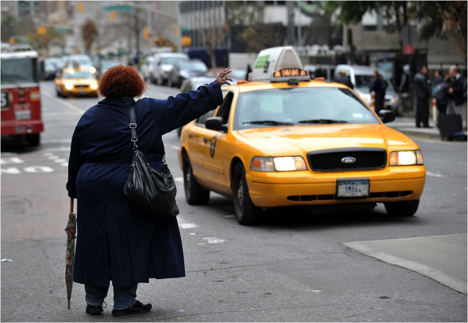 USA NYC Taxi lady hailing source - thedailybeast