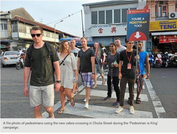 Malaysia Penang Pedestrian in King crosswalk