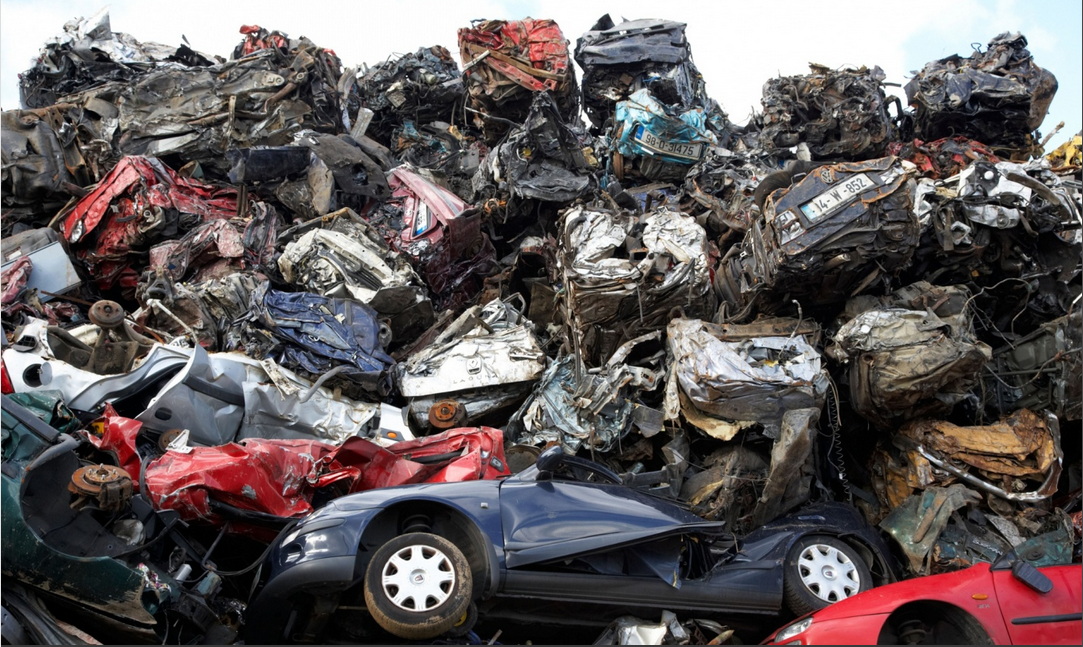 Piles of crushed cars at a metal recycling site in Belfast, Northern Ireland. Photograph- Alamy
