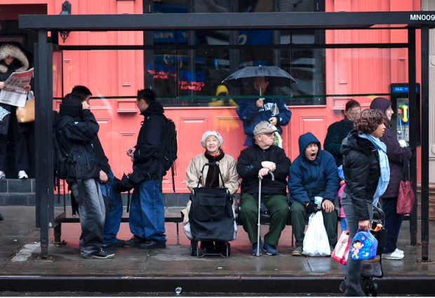USA people waiting bus stop in the rain - large - source unknown