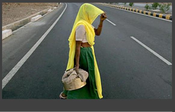 india woman crossing highway