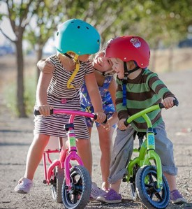 children with push balance bikes