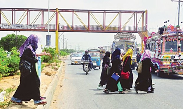 pakistan Karachi ladies crossing traffic footbridge