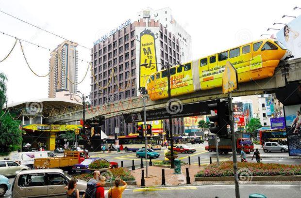 Malaysia Kuala Lumpur monorail at intersection