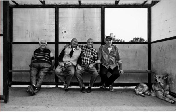 malta-bus-stop-men-and-dog-waiting