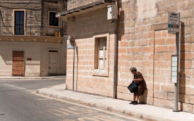 malta-marsaxlokk-bus-stop-old-lady-waiting