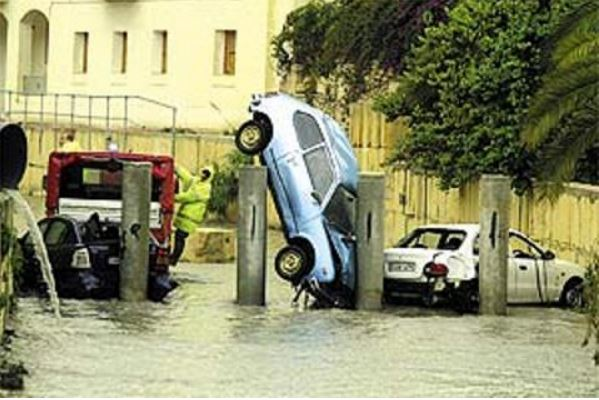 malta-road-after-flood-cars