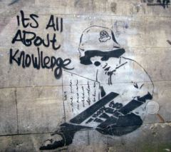 uk-banksy-street-art-child-reading-knowedge