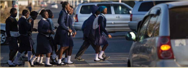 Zambia Lusaka - school girls crossing street in traffic