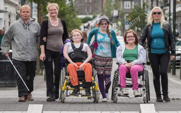 iceland Reykjavik handicapped group on street - 2